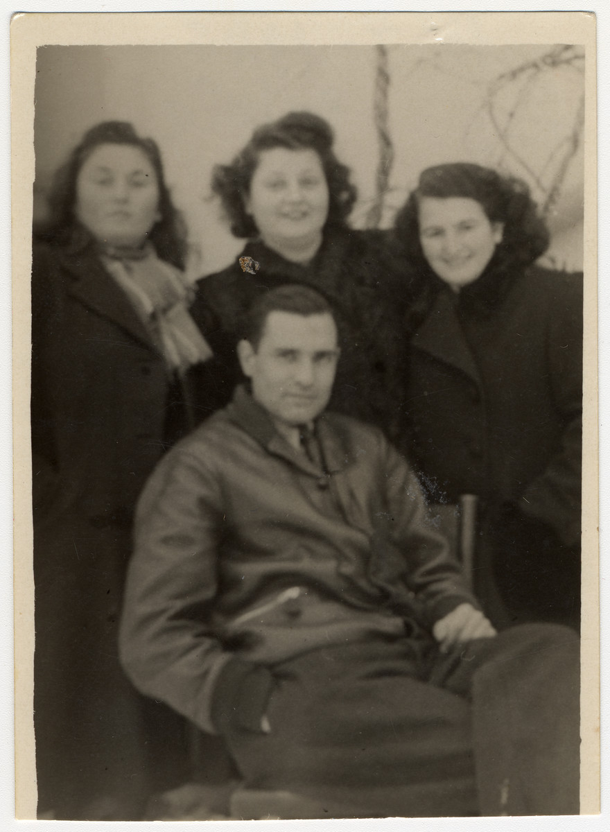 Group portrait of Jewish survivors from Bitola.  Among those pictured are Jozef Kamhi, first and last president of the postwar Jewish Community of Monastir 1945 -1948 (front); and (left to right) Luna Ishah, Zhivka (surname unknown) and Jamila Kolonomos.  The photograph was taken in front of Jamila's house in Bitola.