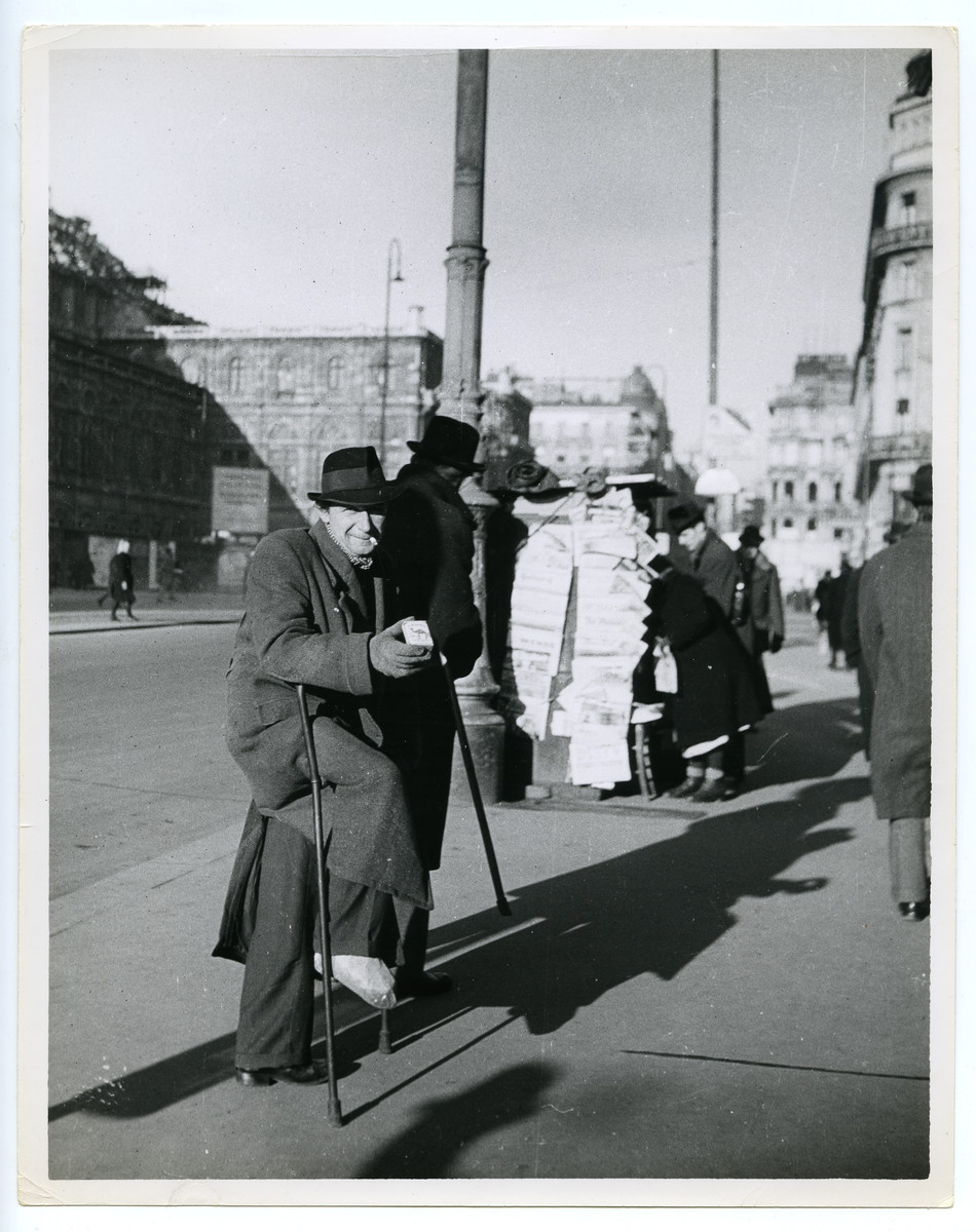 A black marketeer stands on a street corner in Vienna,