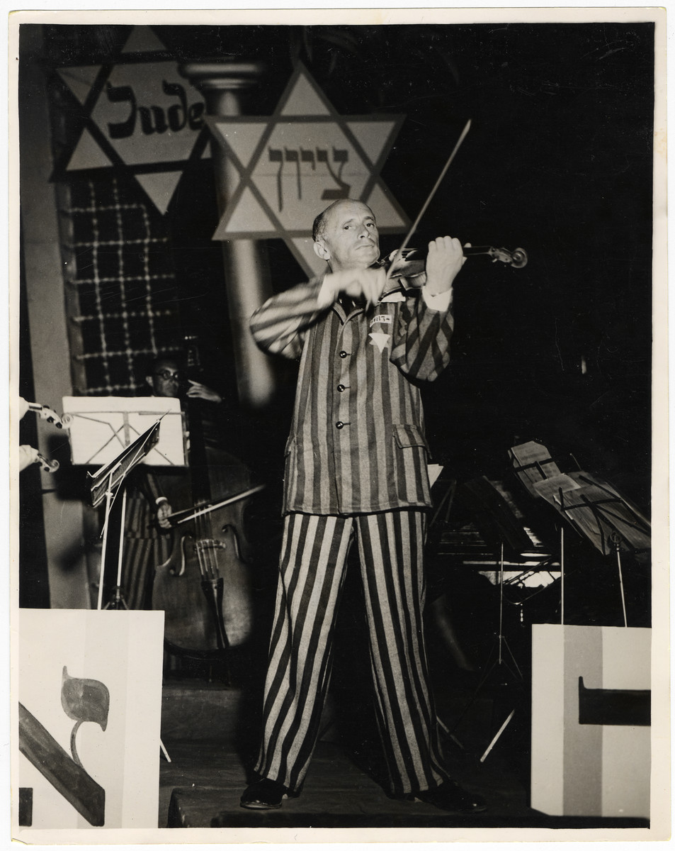 Michael Hofmekler the conductor of the Saint Ottilien Ex-Concentration Camp Orchestra performs a concert in Munich for American soldiers and UJA staff.