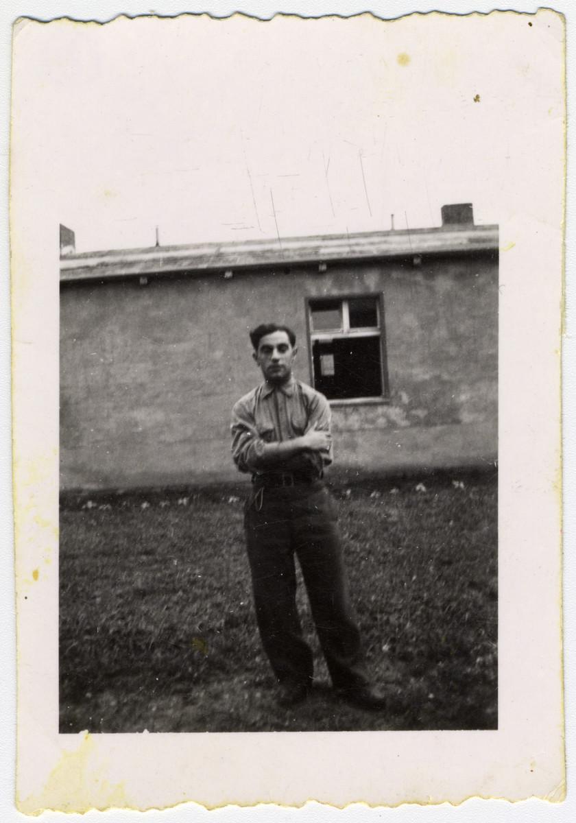 Max Beker, a Jewish and Polish prisoner-of-war, stands outside a barracks of Stalag VIIIA.