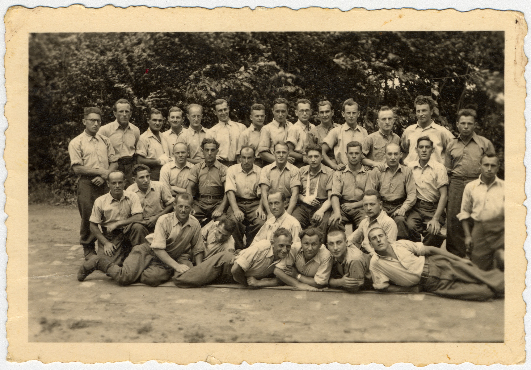 Arbeitskommando on Dominium.  Max Beker is pictured in the middle row, second from the left.