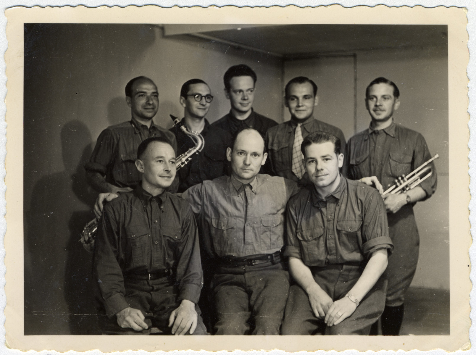 """Group portrait of members of the prisoner orchestra of Stalag VIIIA.  The original caption reads: """"To my comrad Beker as a souvenir of our captivity."""""""