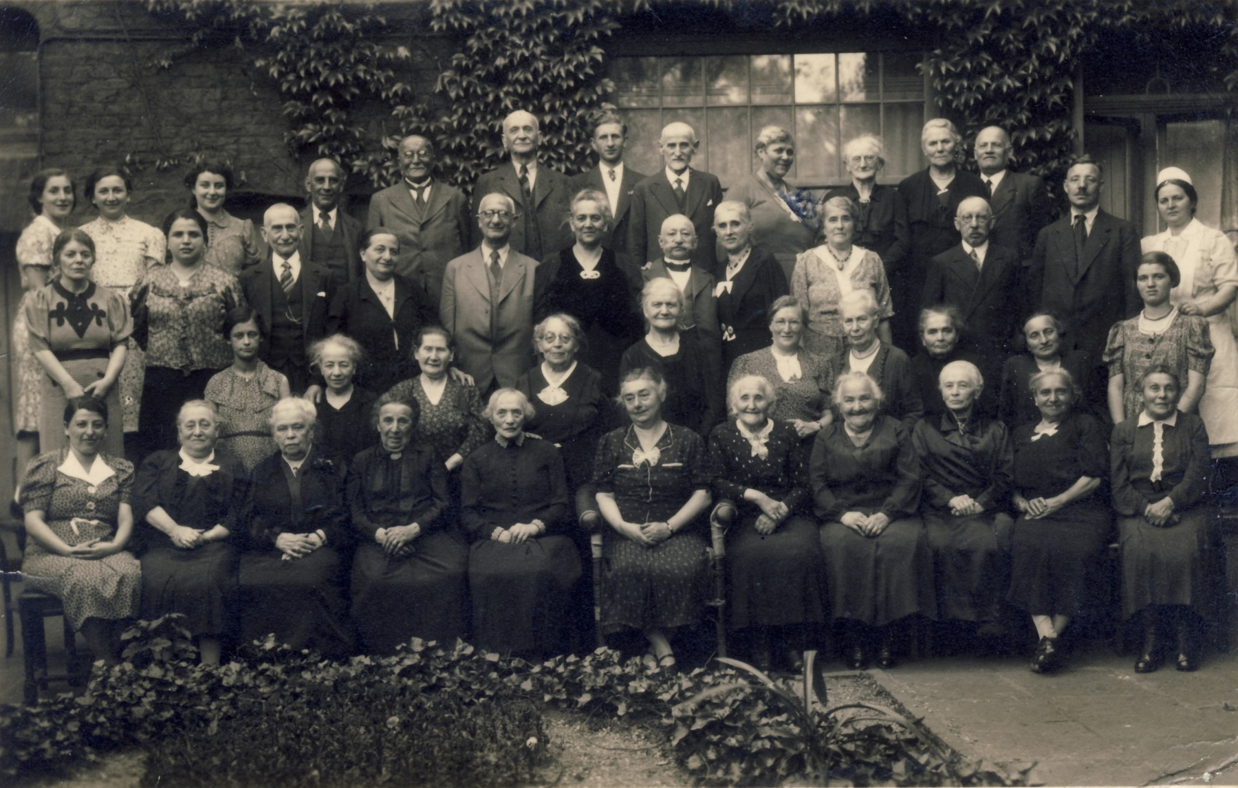 Group portrait of the residents of a Jewish senior home in Muenchen-Gladbach.  Among those pictured is Katherine David, grandmother of the donor (front row, third from left).  The family was informed by a Mrs. Cohen that she died on the train to Theresienstadt.  Also pictured is Josef Willner (standing second row from the back , third from the left).