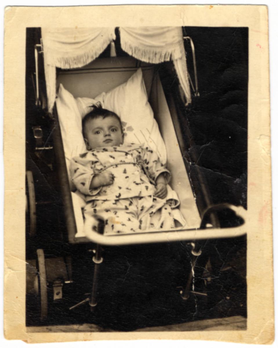 Portrait of Rifka Lifschitz in her baby carriage.