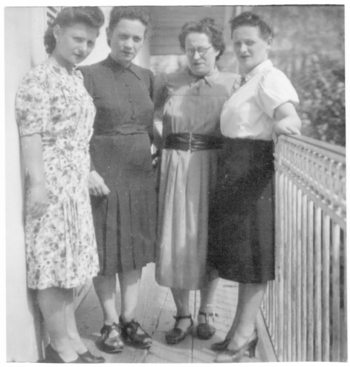 Four Jewish sisters pose on the balcony of an apartment in Brides-les-Bains where they are in hiding.  Pictured are Nezi Orenstein, Cecile Rachlin, Feige Hodak, and  Claire Lazarovitch.