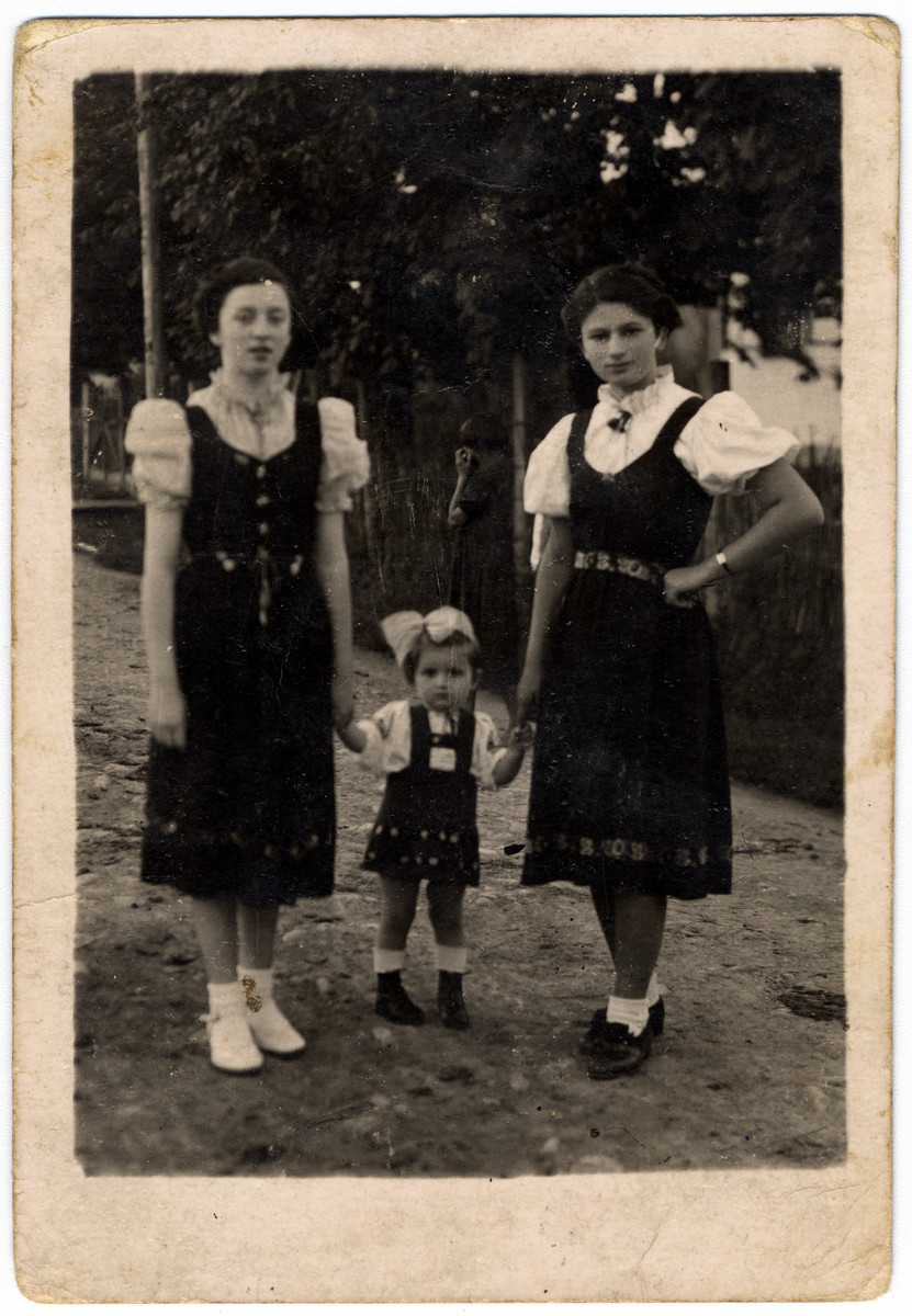 Rifka Lifschitz holds hands with her aunt Bayla Meerbaum (right) and their cousin Bayla Shulwof.