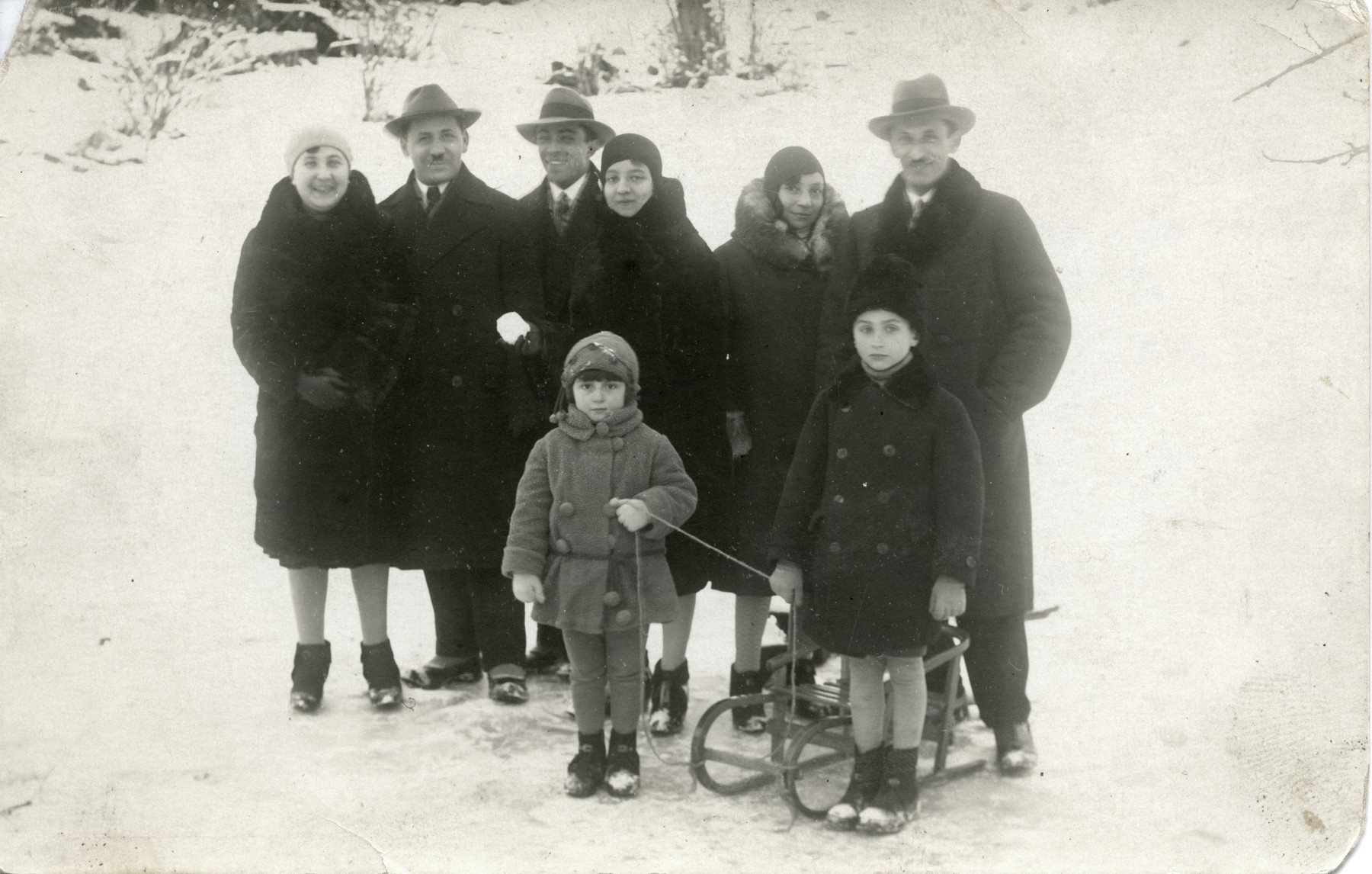 Baruch Hershstyn (2nd from left) poses in the snow with his family and children.