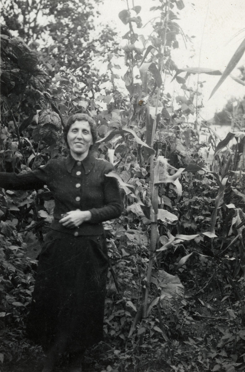 Yocheved Schaechter (mother of the donor) stands in the yard of her home in Tacovo.