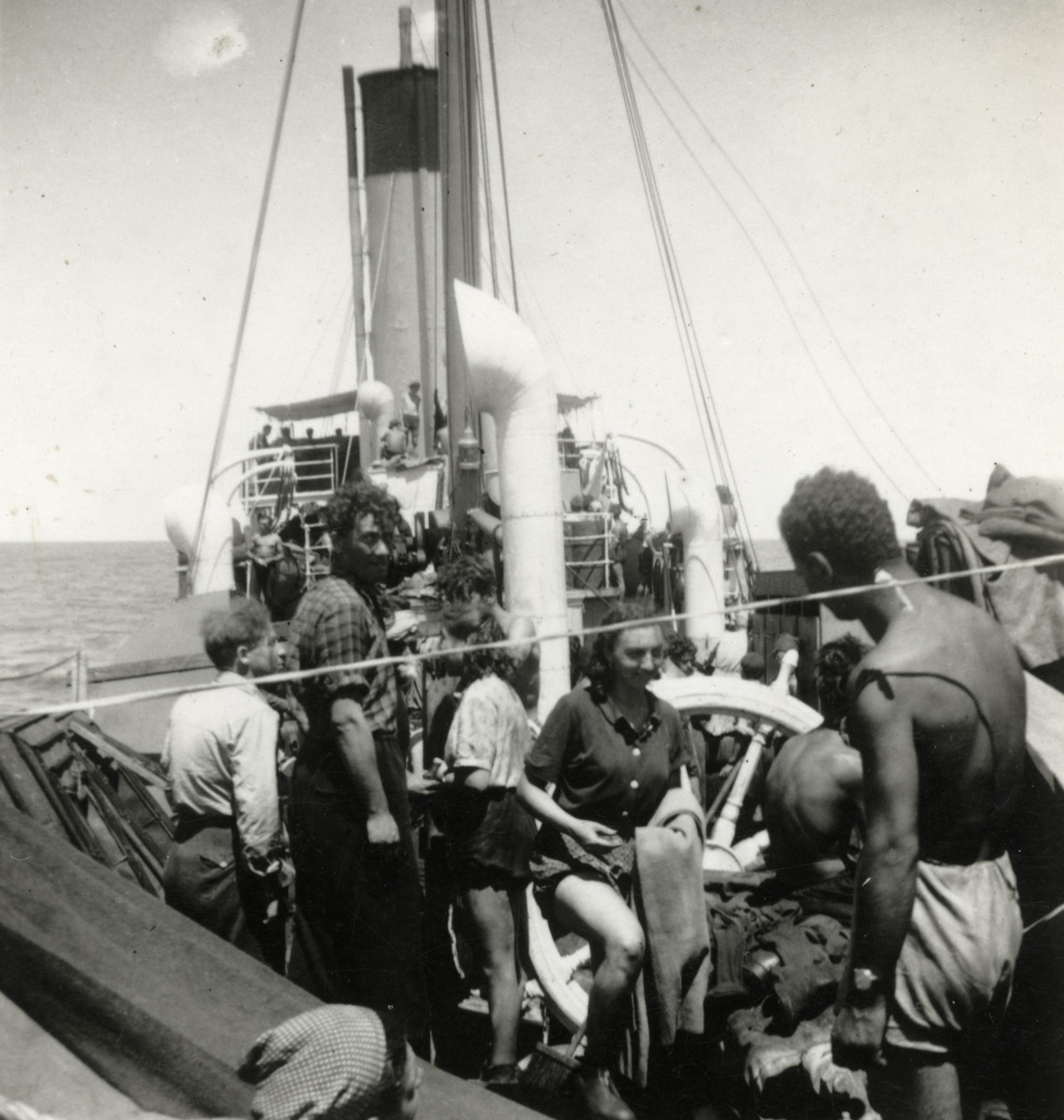 Jewish refugees stand on the deck of a Haganah ship en route to Palestine.  Esther Schaechter is in front.