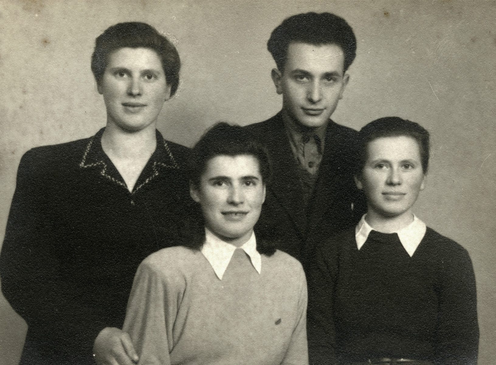 Portrait of four members of the Zionist underground in Budapest.  Pictured in the front row are Rachel and Zippi Schaechter.  Pictured in the back row are Esther Schaechter and Efra Agmon.