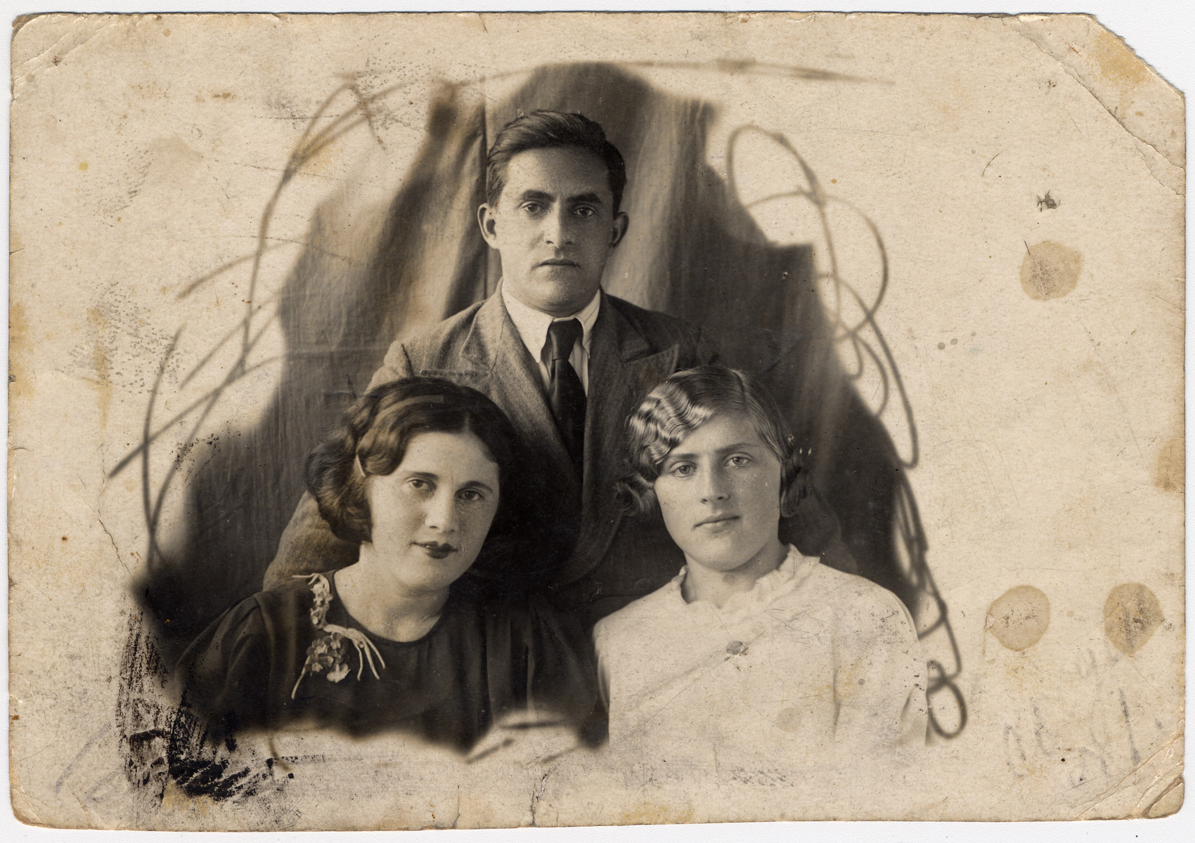 Studio portrait of Petya Ziegelman with one of his sisters (left) and his wife Fania (right).
