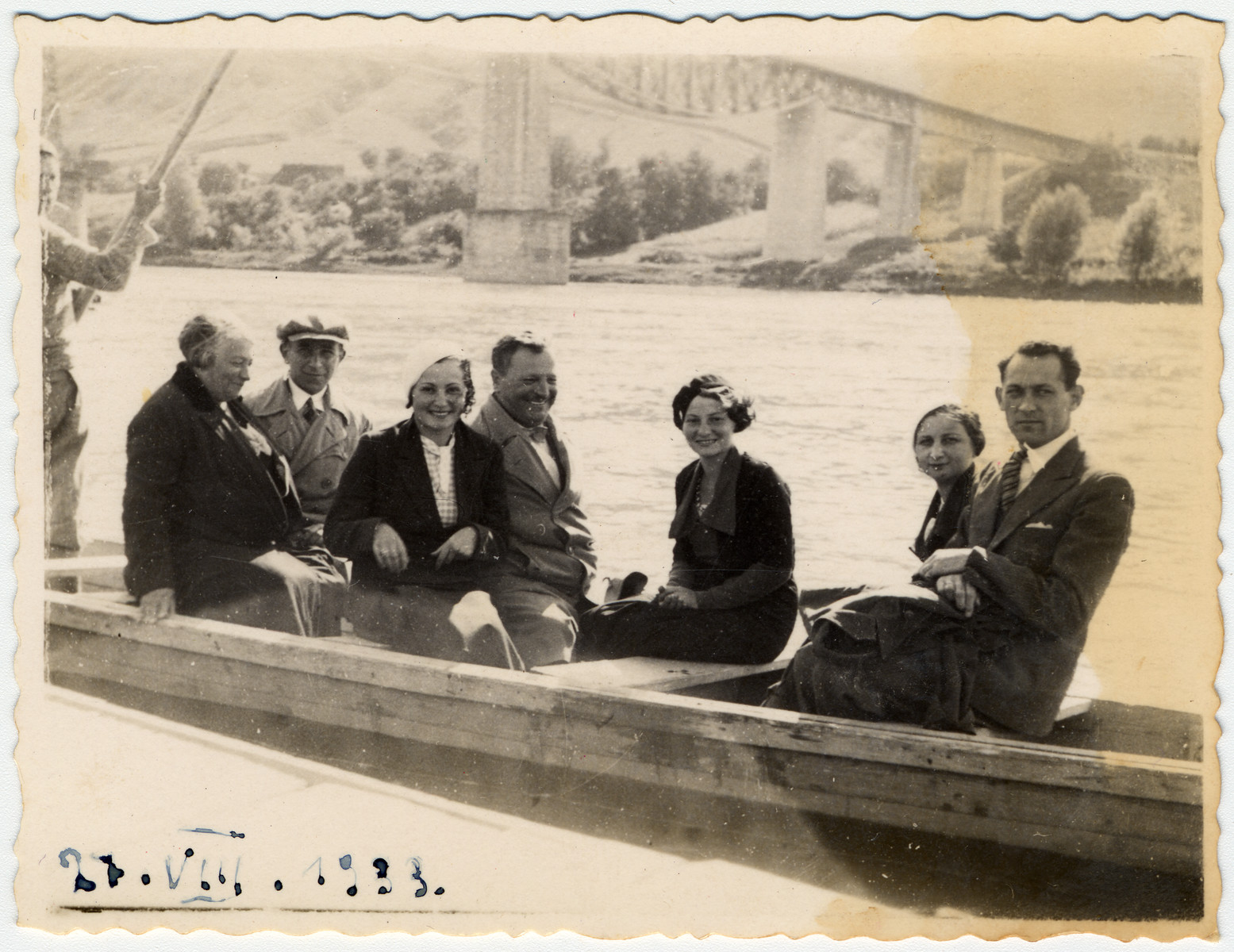 The Litman family poses in a boat in prewar Poland.  From left to right are Grandmother, Luciek, Unknown, Grandfather, Olga Litman (middle), Klara Kautzr, and Isaac Litman (far right).