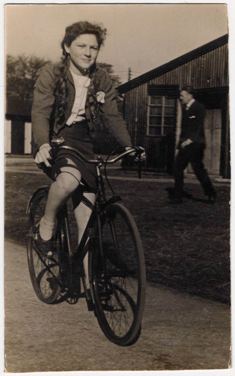 Halina Litman rides a bicycle after she moved to Maghol, England, following her survival in hiding.