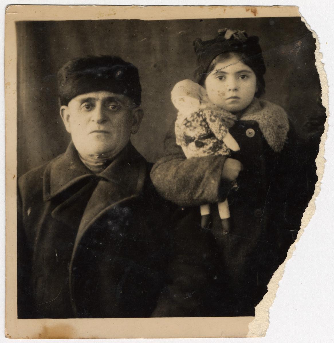 Shmuel Ziegelman poses with his surviving granddaughter Slava.