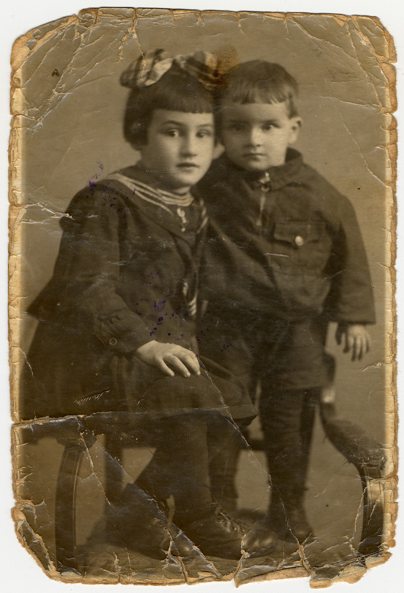 Studio portrait of Bella and Izya Khanuk, both of whom were murdered in an Aktion 1942.