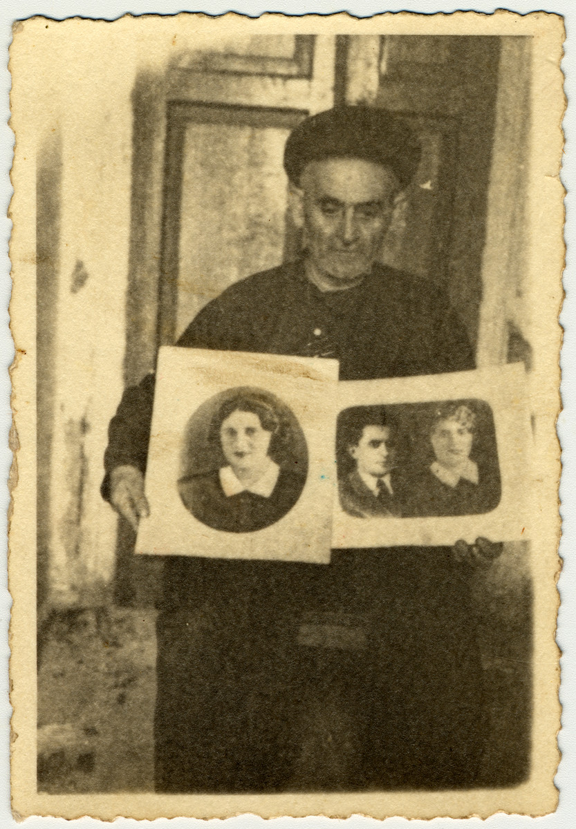 Shmuel Ziegelman poses with two portrait of his mudered children after the war.  The photo on the left is of his daughter Fira. the photo on the right is of his son Petya and daughter-in-law Fania.