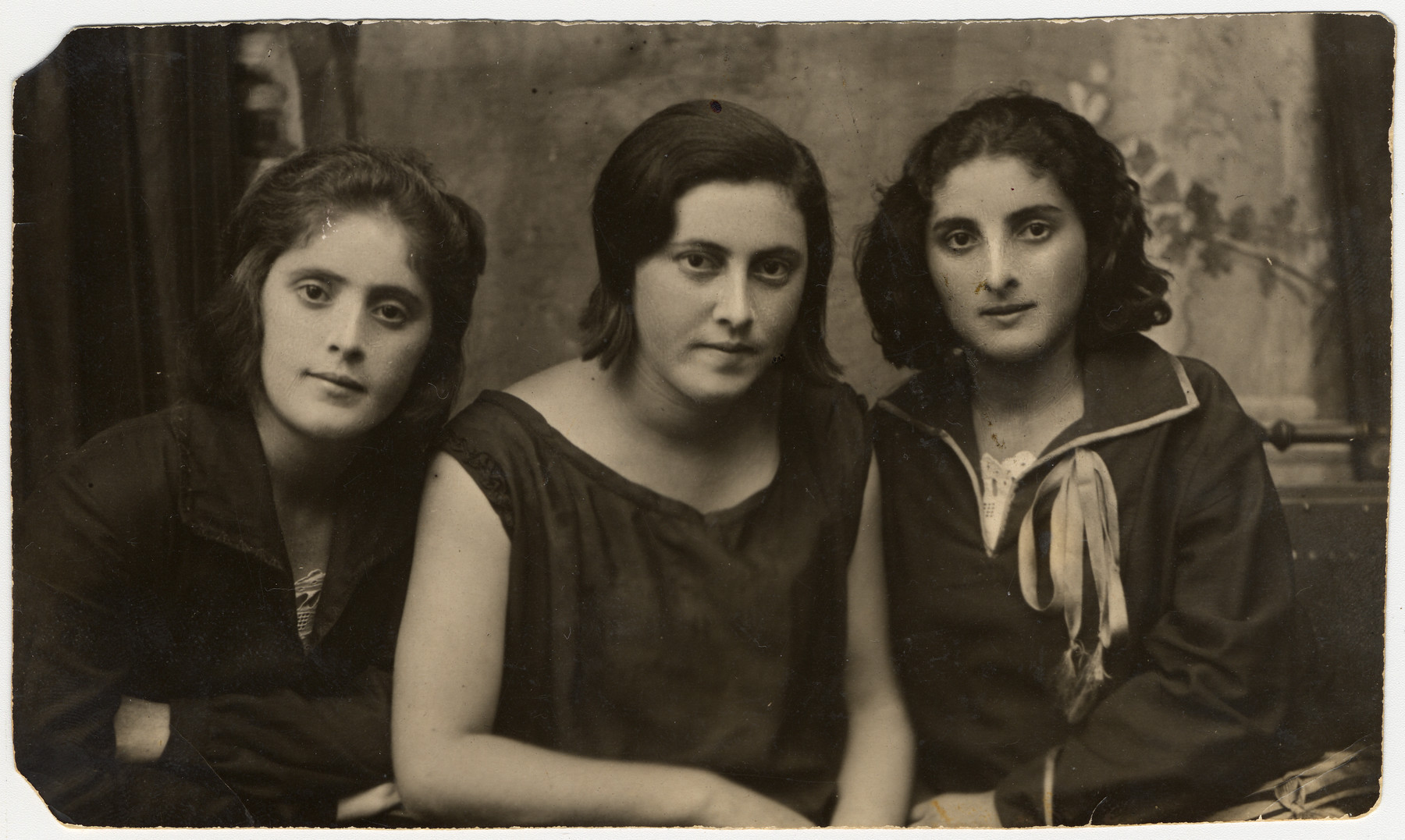 Studio portrait of three sisters Sonja (Sheyna), Liza and Yeva (Chaya) Cygelman.  Only Yeva and Liza survived the war