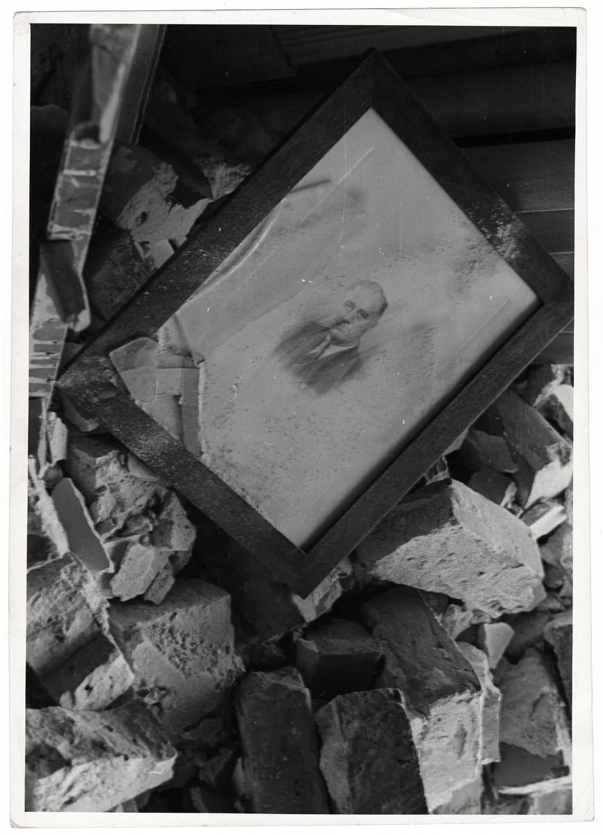 An intact portrait of President Roosevelt  lies amidst the rubble of the destroyed officer of the American Consulate General in Warsaw.