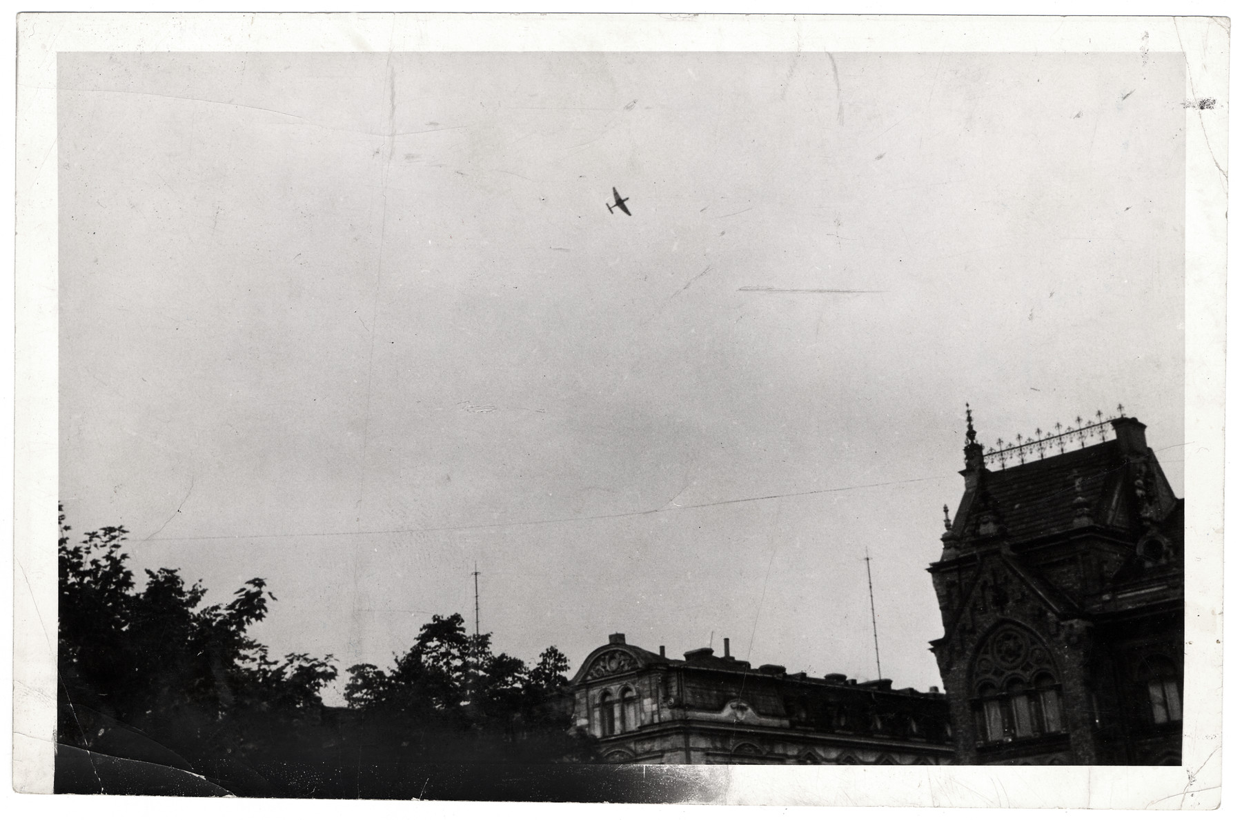 A German bomber flies over Warsaw.