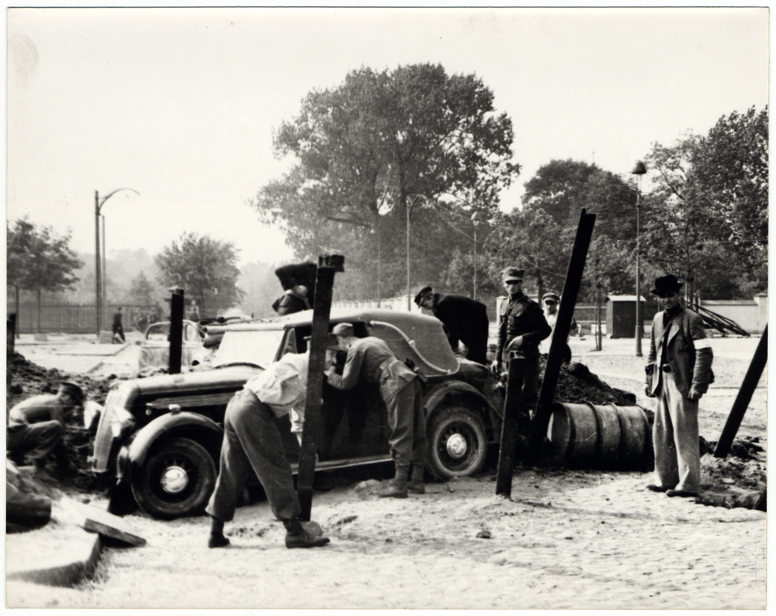 Julien Bryan's car is stopped by the Polish police in besieged Warsaw.