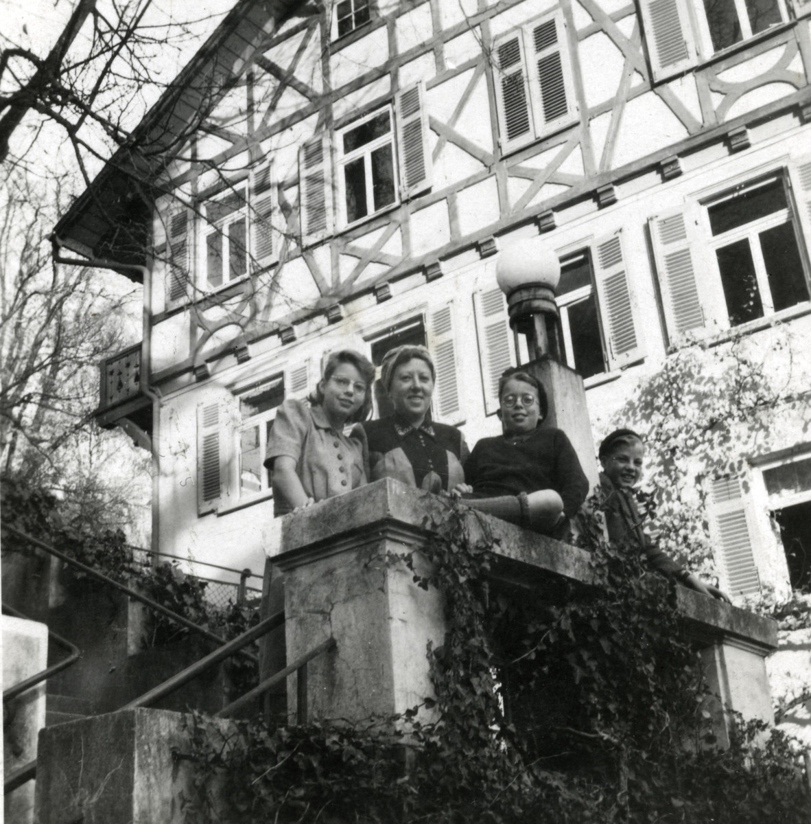 The Joshua family stands outside the Jordanbad sanitorium near Biberach a few months after their liberation.  Pictured are Karin, Elisabeth, Henry and Jacob Joshua.   The sanitorium Jordanbad was run by Franciscan nuns. It was requisitioned by the French occupying army to be used by the UNRRA for the convalescence of concentration camp survivors and displaced persons.   The photo was taken by Julius Peter Lunzer who was an officer in the Canadian Navy and the son of my mother's sister, Celine Lunzer who lived in Londen. He came to visit us in a resplendent uniform and lifted our spirits greatly. Besides Julius Peter Lunzer another son and two daughters of Celine also served in the British army.