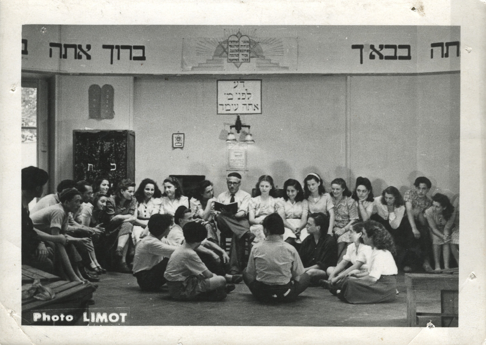 "Felix Goldschmidt, director of the Versailles children's home for religious teenagers, reads aloud inside the home's synagogue.  The inscription on the top reads: ""You are blessed in your coming and you are blessed in your going out."""