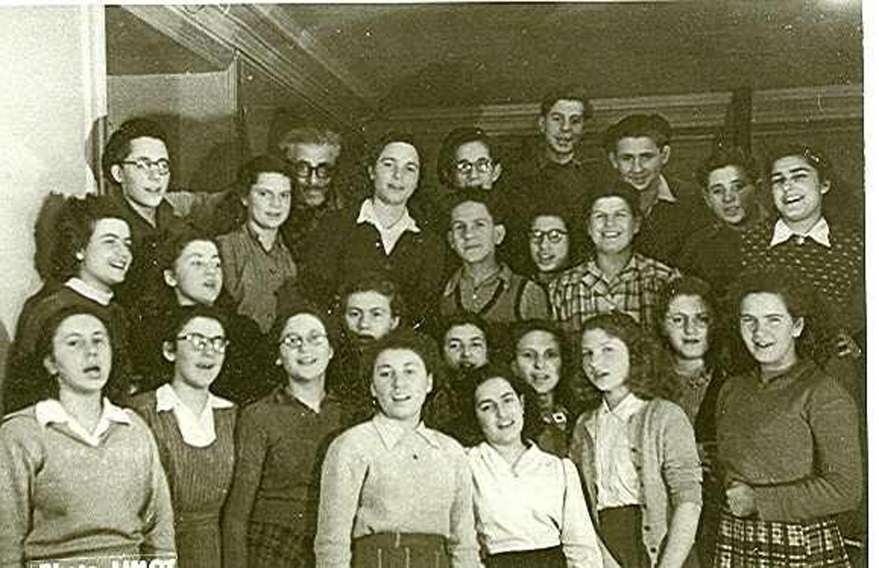 Group portrait of the choir of the Versailles children's home, an OSE home for religious teenagers.  Felix Goldschmidt is pictured in the back row third from the left.