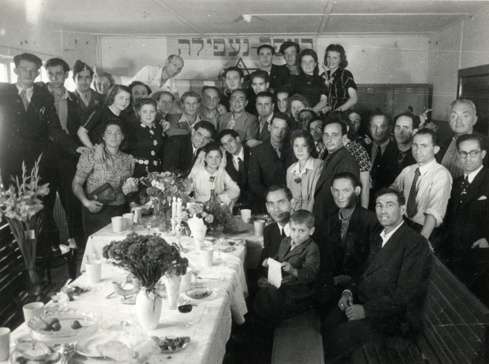 Displaced persons in the Schlachtensee camp celebrate the wedding of Chana Grossman and Nathan Schwarzfeld.  Jonas, Rywka and Benjamin Markowicz are on the right.  Rywka wore a dress from the camp's store room that was sent from America.