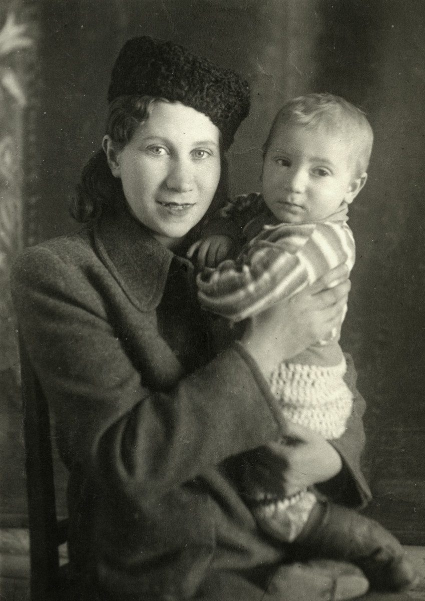 Studio portrait of Rywka and Benjamin Markowicz.   Benjamin is wearing boots made by his father and Rywka wears a Russian hat to appear more Russian.