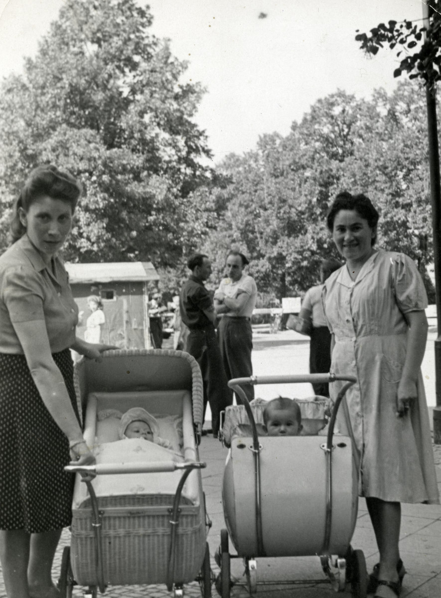 Rywka Markowicz (left) and Ruth Spiler Cymet push their babies in carriages in the Tempelhof displaced persons camp.  Ruth's baby is Lila Sara Cymet.
