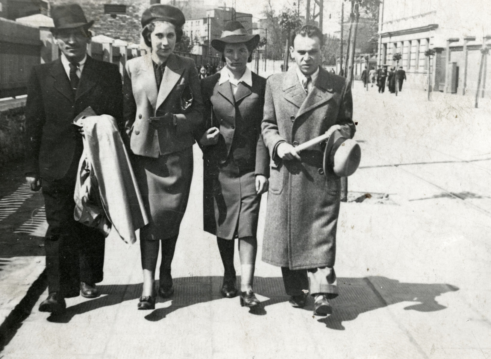 Jonas and Rywka Markowicz walk down a street in Sosnowiec shortly before the start of World War II.  Jonas and Rywka Markowicz are on the left.