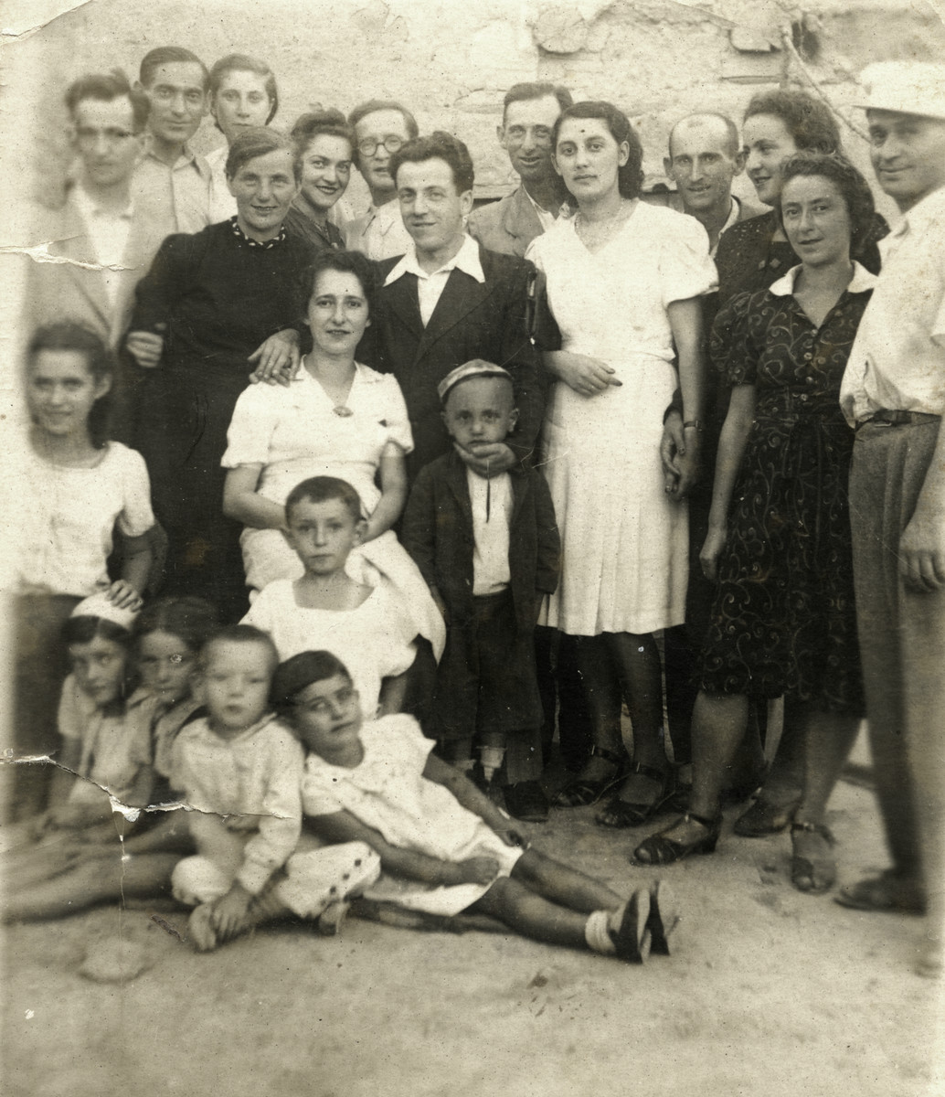 The donor's parents, other Jewish refugees and Uzbeki friends celebrate a wedding in Bukhara in the 1940's.   Jonas and Rywka Markowicz are pictured in the top left of the photograph.