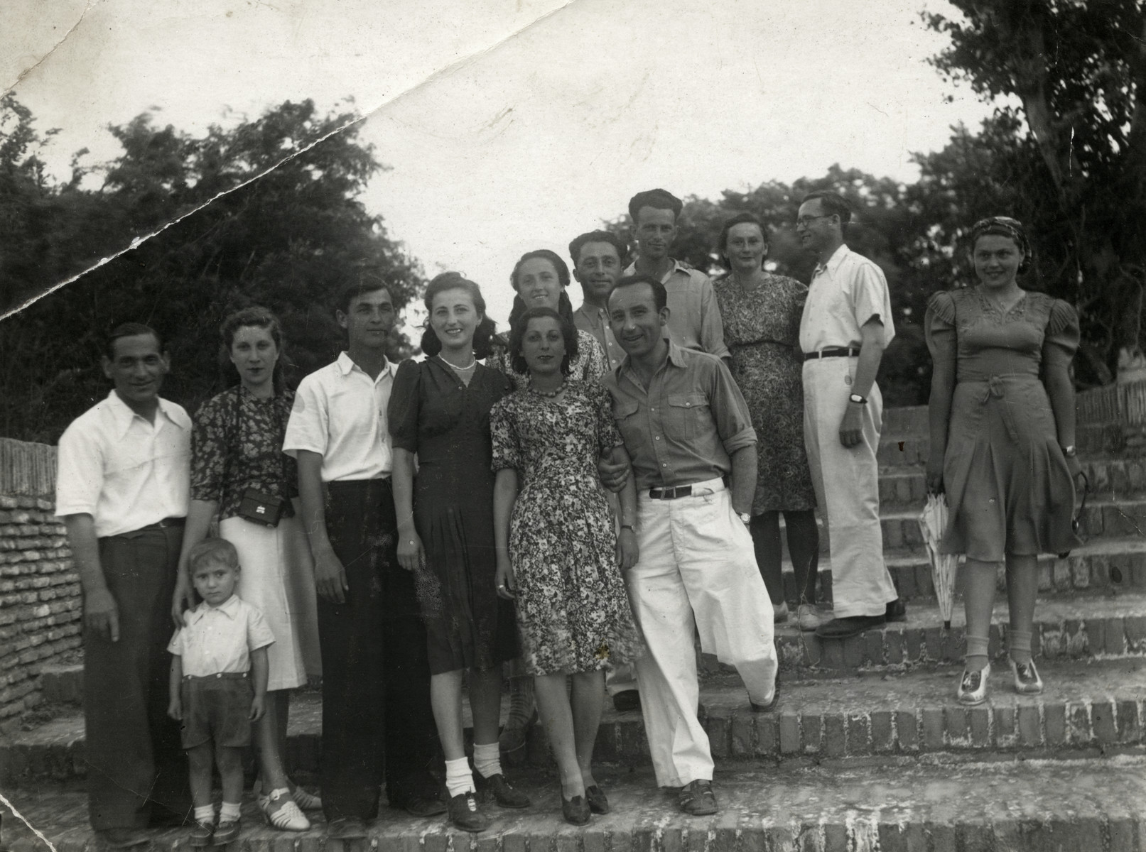 Polish Jewish refugees in Bukhara pose for a group photograph while on an outing.  Jonas, Benjamin and Rywka Markowicz are on the left.