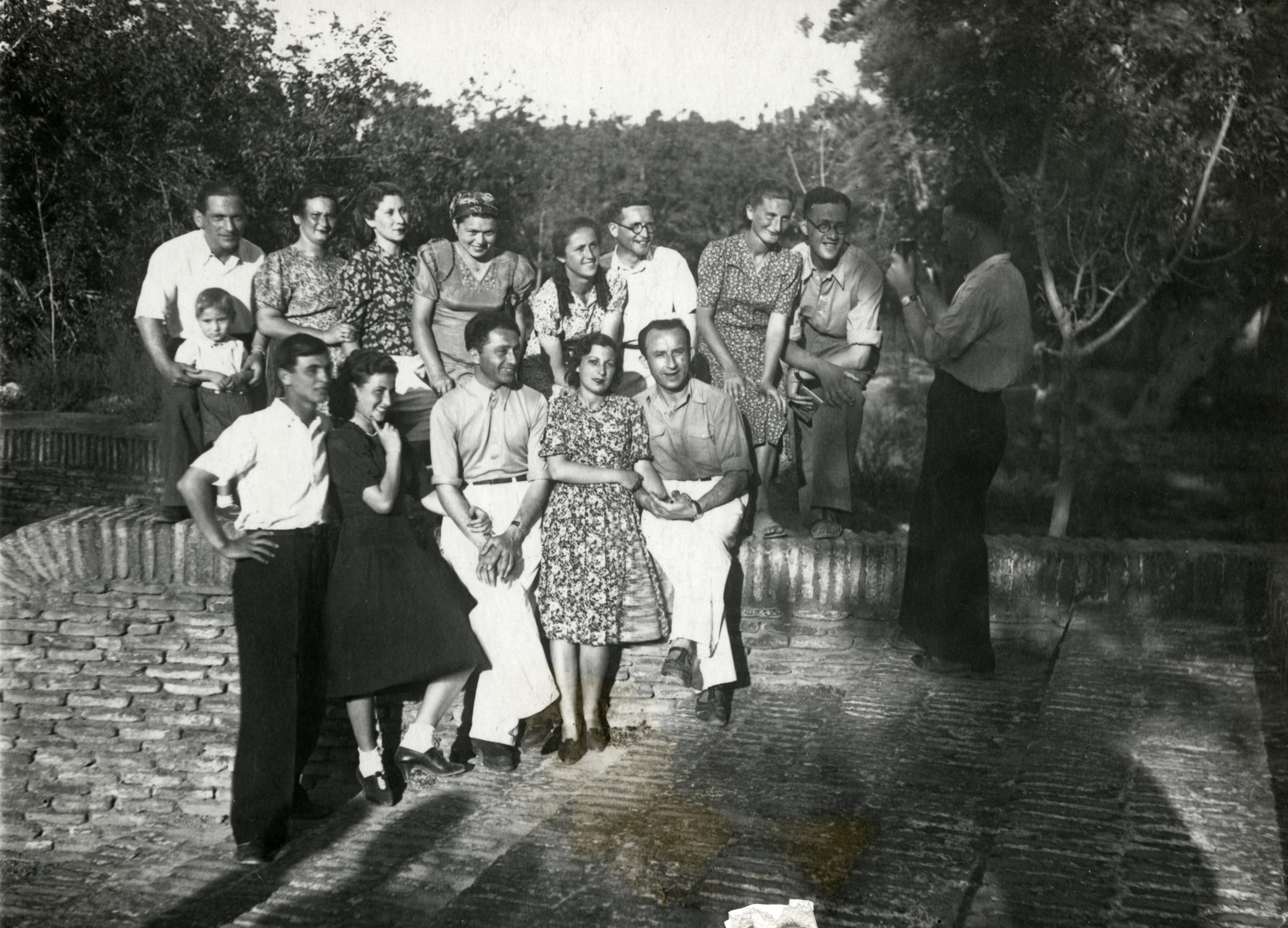 Polish Jewish refugees in Bukhara pose for a group photograph while on an outing.  Jonas, Benjamin are on the top left; Rywka is third from the left of the top.