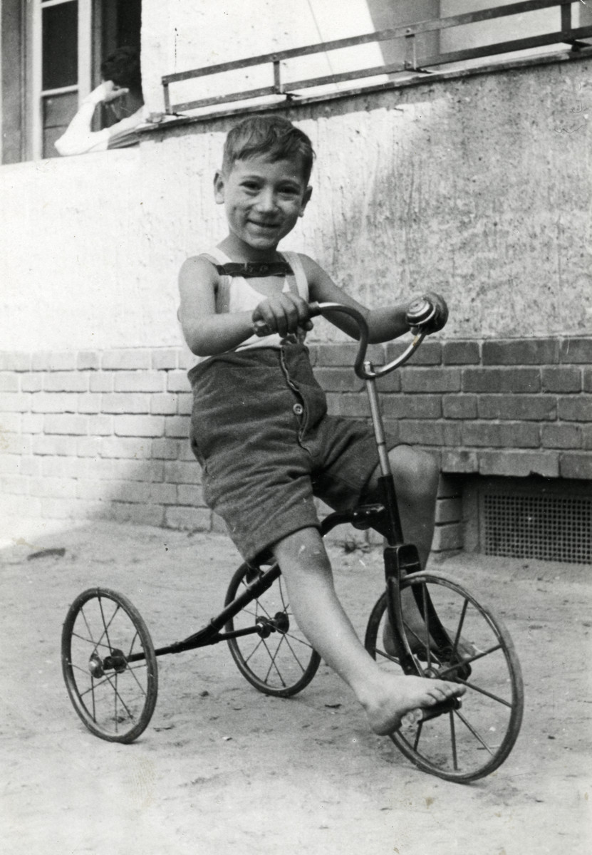 Five-year-old Benjamin Markowicz rides his bicycle in the Mariendorf displaced persons camp.