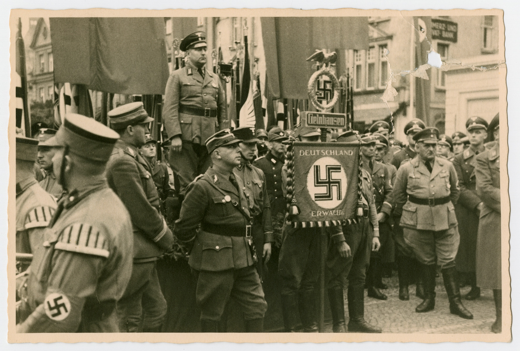 Nazis carrying a  Germany Awake banner gather at a May Day Nazi party parade in Fulda.