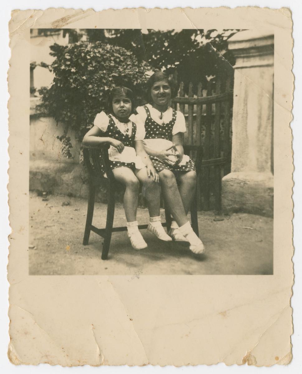 Miriam and Hanka Wertheimer share a garden bench.