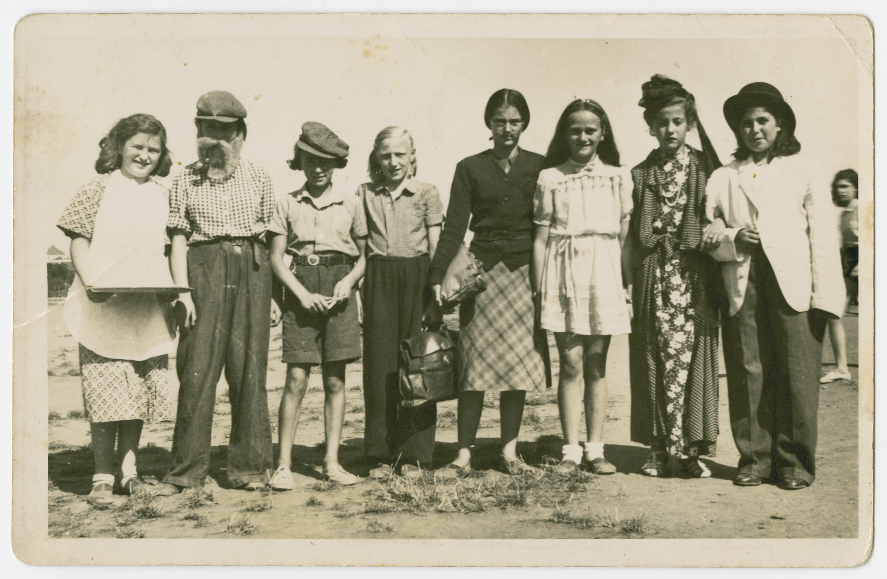 Group portrait of Jewish children in their Purim costumes [probably in the Ben Shemen agricultural school].  Miriam Wertheimer is pictured on the right.