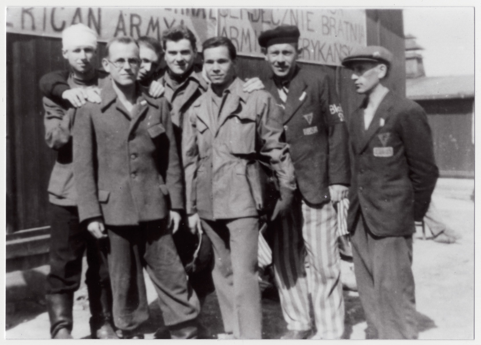 "Group portrait of newly liberated Polish prisoners in the Buchenwald concentration camp.  The original caption reads: ""The older P.W.s were Polish business men and owned factories that were confiscated by the Germans"""