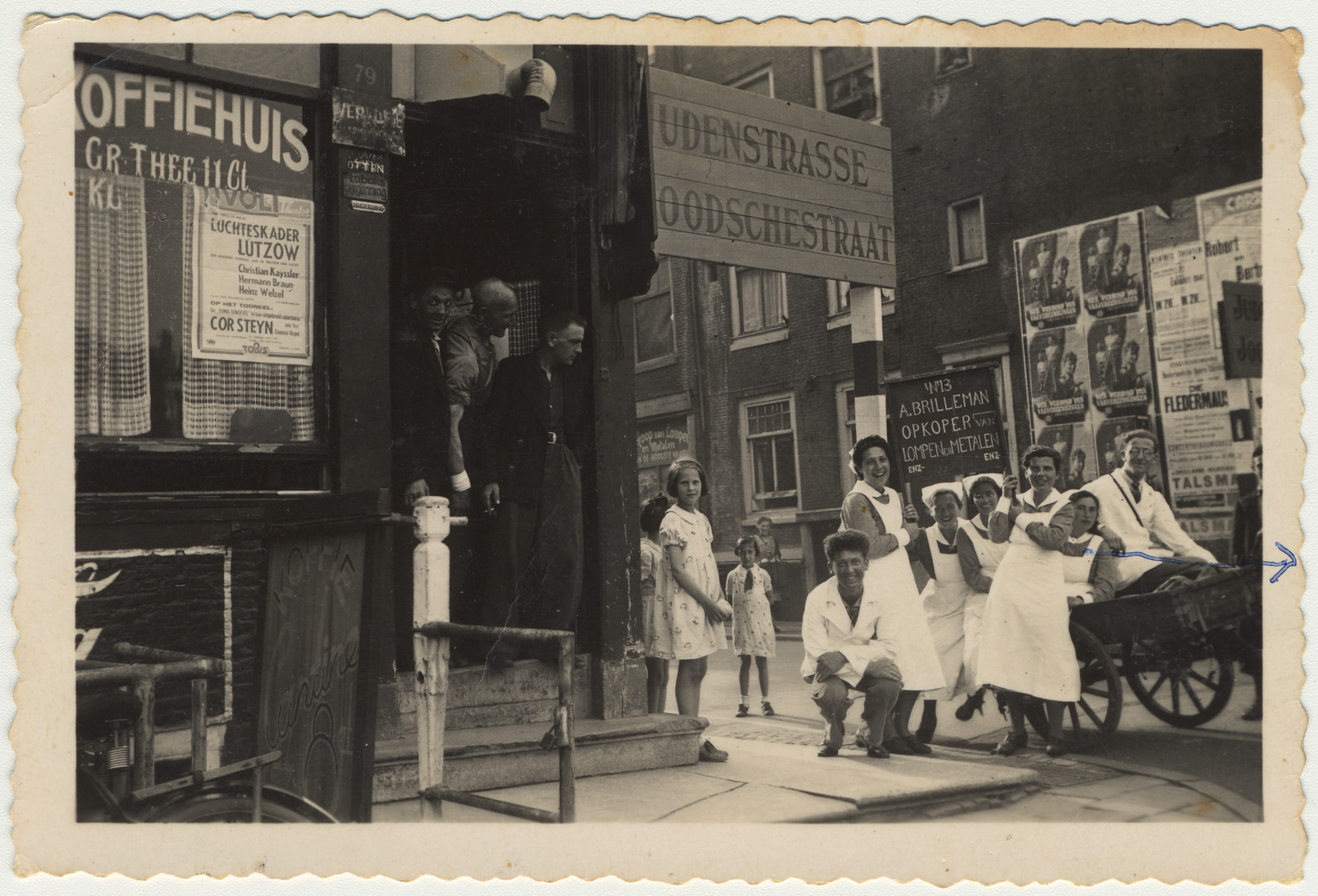 Jewish nurses and nursing students gather around a cart outside a coffee house on Judenstrasse.  Among those pictured is Edith van Dam.
