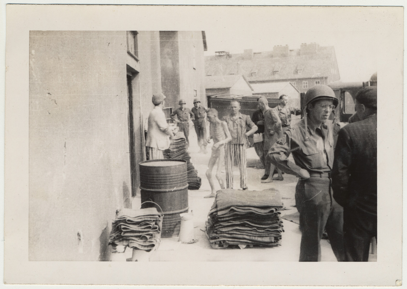 Original caption:  Inmates are stripped and sprayed with DDT.