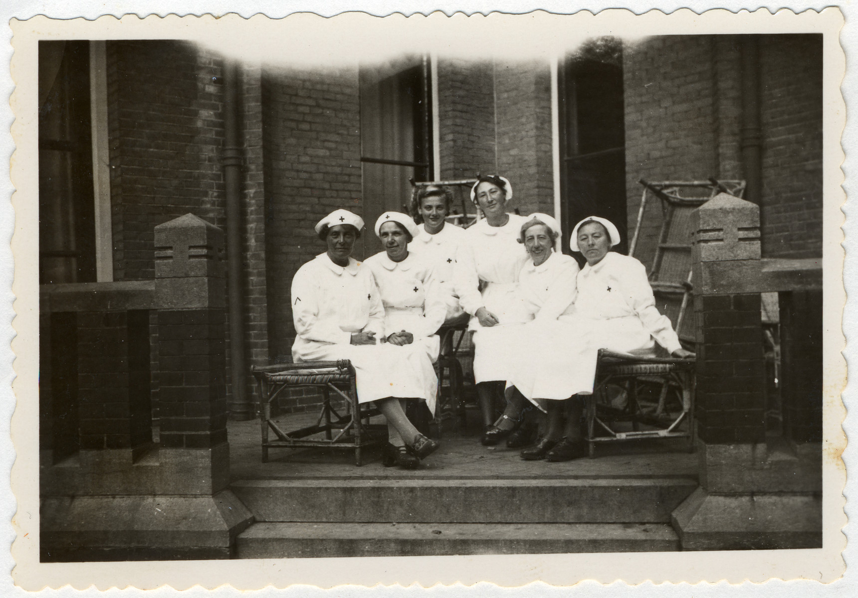 Group portrait of Dutch Red Cross nurses.  Among those pictured is Minnie van Dam.