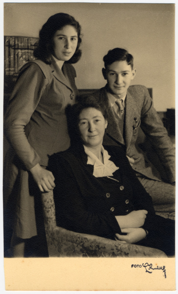 The Vromen family poses for a postwar studio portrait.  Pictured are Clary, Minnie and Jaap Vromen.