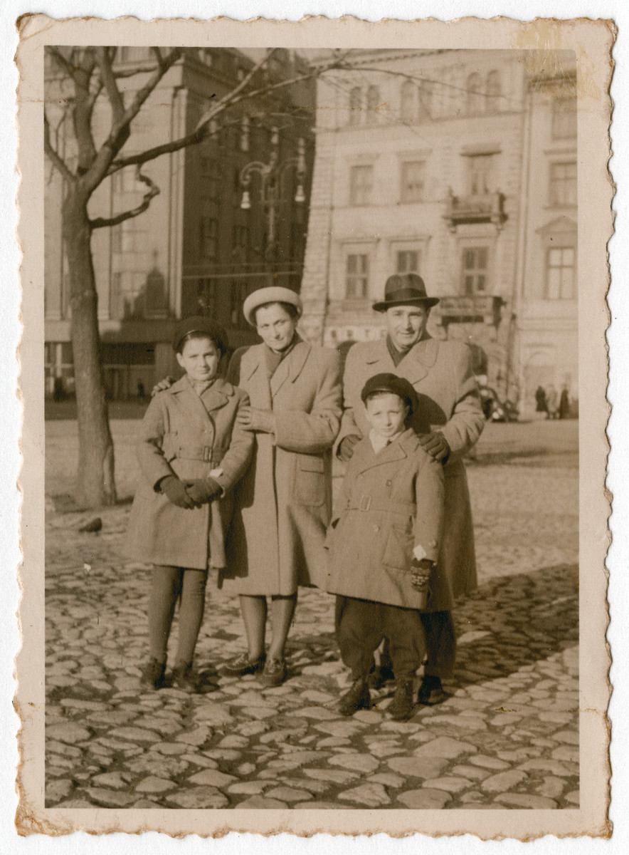 The Chiger family stands on a street in Krakow after the war.  Pictured are Kristine, Paulina, Ignacy and Pawel. They survived as a family hidden in a sewer.