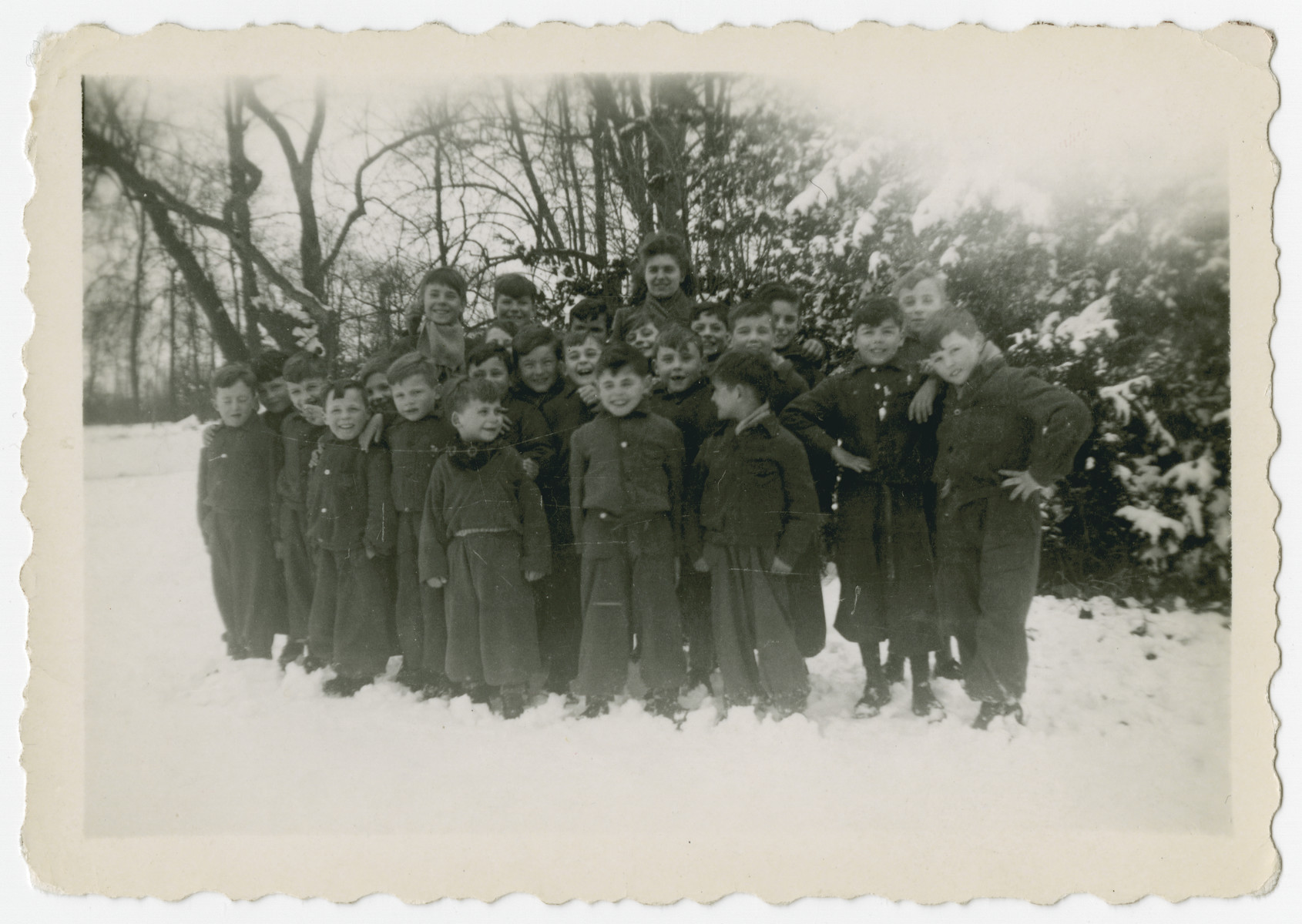 Elementary school boys, many of them Jewish children in hiding, pose in the snow outside the Chateau de  Beloeil.