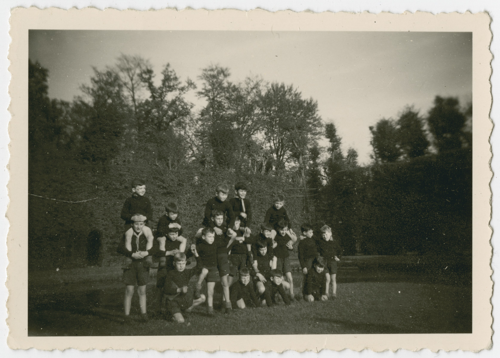 Elementary school boys, many of them Jewish children in hiding, pose on the grounds of the Chateau de Beloeil.
