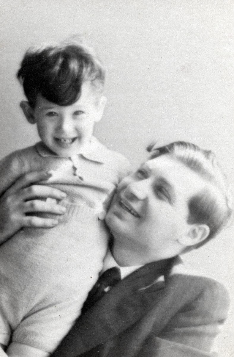 Close up portrait of Moses Rosenbaum holding his young son Herman