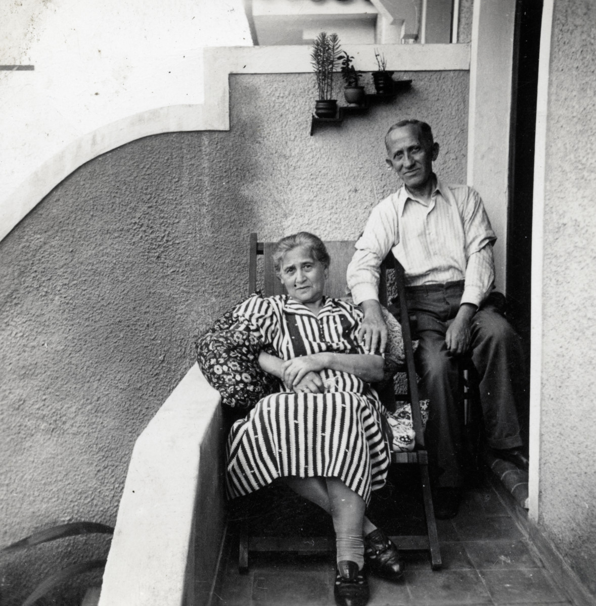 Zvi's maternal grandparents, Mr. and Mrs. Izaak Weissbrod, pose on their porch after immigrating to Brazil.