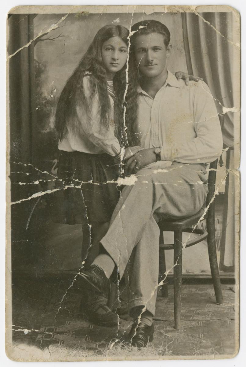 Studio portrait of Yehuda Bielski and his niece Shifra.
