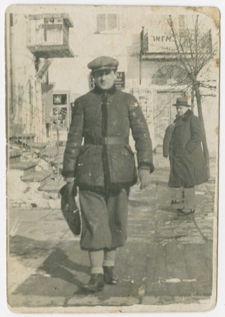 Yehuda Bielski walks down a street in prewar Nowogrodek.